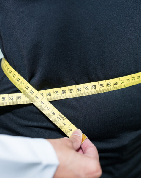 Doctor,Measuring,Waist,Of,Patients,,Checking,For,Body,Mass,Index