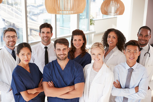 Happy and healthy doctors and nurses | Well Health Works